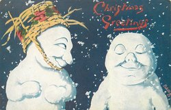 two snow men, one with basket upside down for a hat looks at another asleep